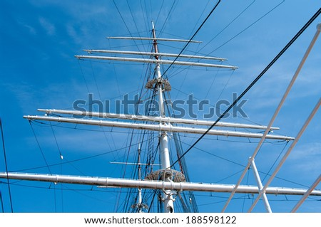 mast yacht without sails against the blue sky  - stock photo