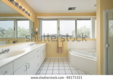 Master bath in home with yellow walls