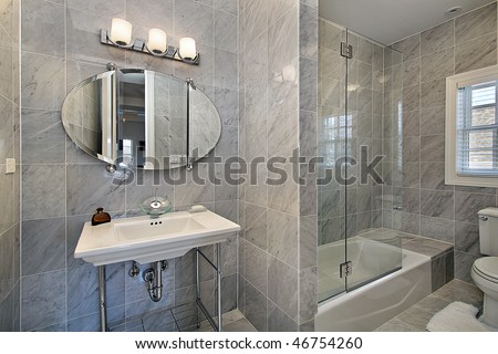 Master bath in luxury home with gray tile - stock photo