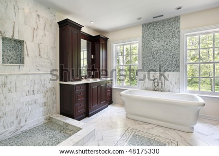 Master bath in luxury home with large white tub - stock photo