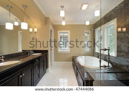 Master bath in new construction home with glass shower - stock photo