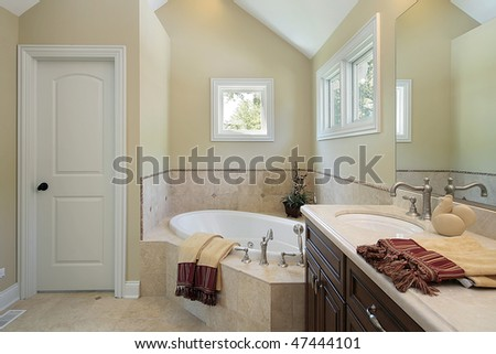 Master bath in new construction home with tub design area - stock photo