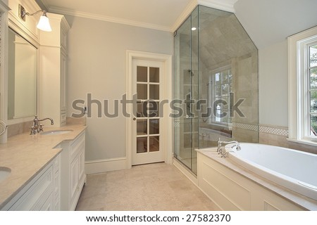 Master bath with white tub