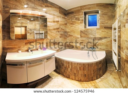 Master bathroom in luxury home with bath and furniture - stock photo