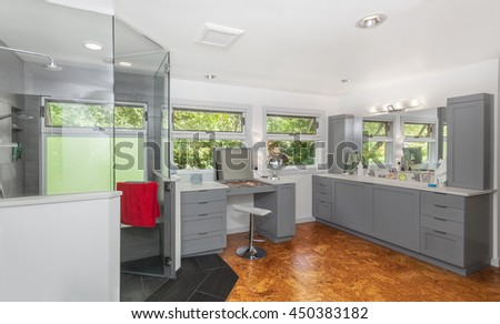 Master bathroom shower, vanity and double ramp sink after remodeling complete - stock photo