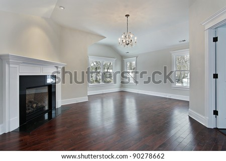Master bedroom in new construction home with fireplace - stock photo