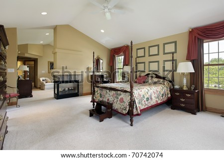 Master bedroom with fireplace and sitting room - stock photo