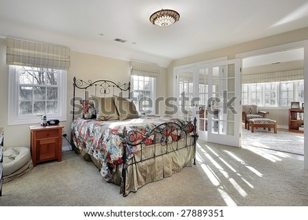 Master bedroom with sitting room - stock photo