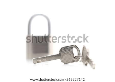 master key and key lock isolation on white background - stock photo