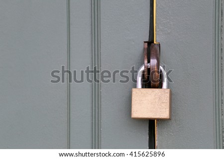 master key is lock of wooden door for concept of security and insurance.