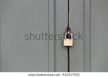 master key is lock of wooden door for concept of security and insurance. - stock photo
