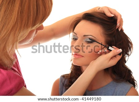 Master of style does to the beautiful girl of make-up. - stock photo