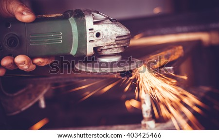 master of welding seams angle grinder - stock photo