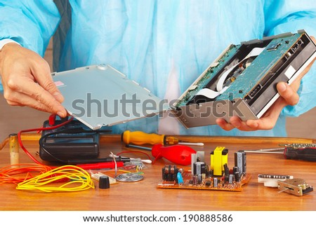 Master servicing electronic components in a service workshop - stock photo