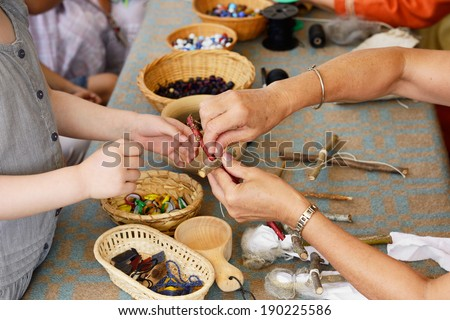 Masters taught to make dolls - stock photo