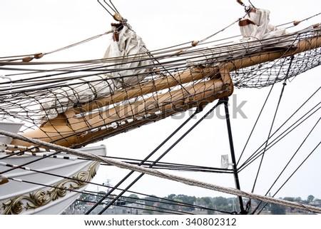 Masts and rigging of a sailing ship close up - stock photo
