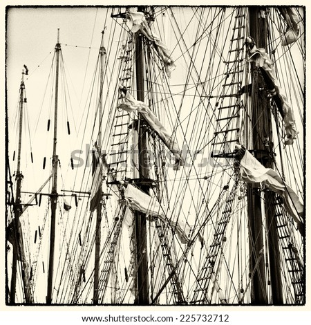 Masts and rigging of old sailing vessels, vintag style photo, sepia colored - stock photo