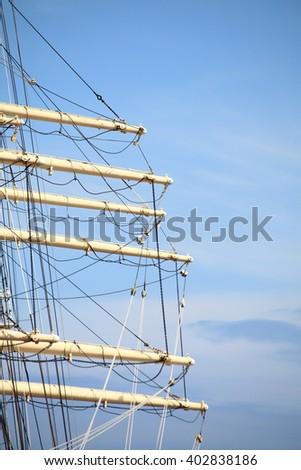 Masts and rope of sailing ship. - stock photo