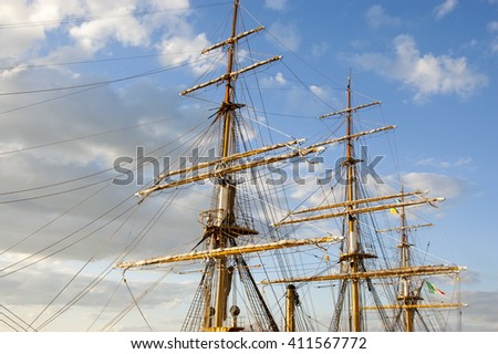 masts of the sailing vessel against the blue sky - stock photo