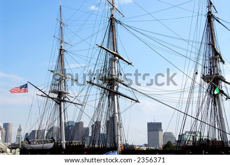 Masts of USS Constitution with Boston skyline in the background - stock photo