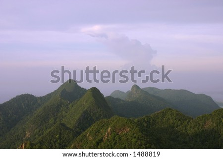 Mat Cincang Mountains at Dusk-Ancient and rugged tropical mountains of Langkawi Island, Malaysia - stock photo