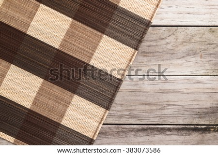 Mat made of wooden sticks texture background. Bamboo mate on wooden table - stock photo