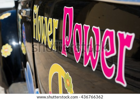 MATALA, CRETE, GREECE - APRIL 22. Flower power inscription on an old beetle car in Matala on April 18, 2016. The small town in the south-central of Crete is famous by the caves and the Hippies - stock photo