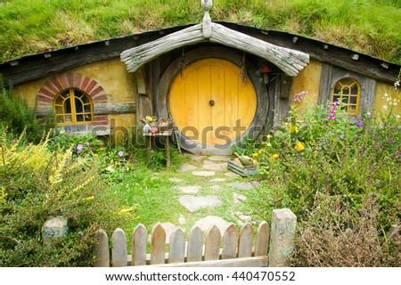 MATAMATA, NEW ZEALAND - JANUARY 20, 2015:  Famous Hobbit hole in Hobbiton Movie set - stock photo