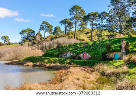 MATAMATA, NEW ZEALAND - JULY 25, 2012: Hobbit houses in Lord of the Rings location Hobbiton, Matamata, New Zealand - stock photo