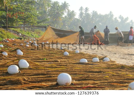 MATARA, SRI LANKA - FEB 12: Fishermen lay out nets after fishing in Mantra, Sri Lanka island on Feb 12, 2012. - stock photo