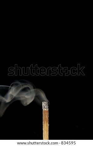 Match blowing smoke away after being put out - stock photo