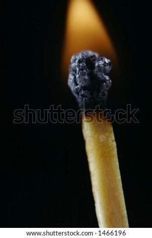 Match head on fire - stock photo