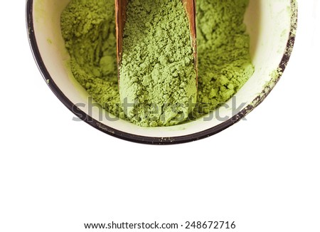 Matcha Tea in the scoop isolated on white background - stock photo