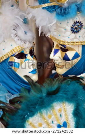 Matched couple in masked costumes at the Venice Carnival - stock photo
