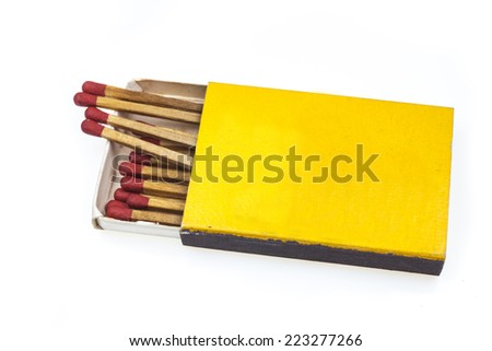 Matches in yellow box on  white background. - stock photo