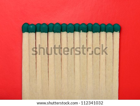 Matches isolated on a red textured background.