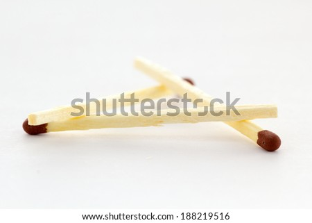 Matches isolated on white background forming a triangle - stock photo