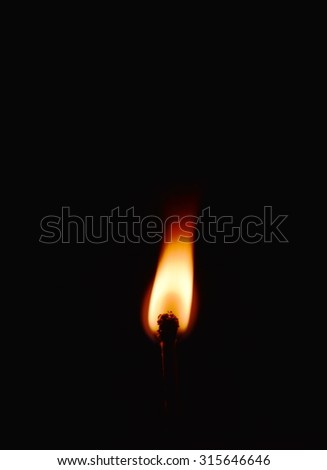 matchstick flame in the dark - stock photo