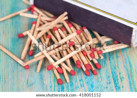Matchsticks over wooden background - stock photo