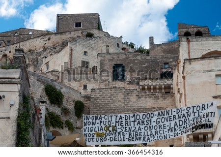 MATERA, ITALY SEPTEMBER 15, 2014: Protest banner against government in Matera ancient town. The city is a UNESCO World Heritage site and European Capital of Culture for 2019 - stock photo