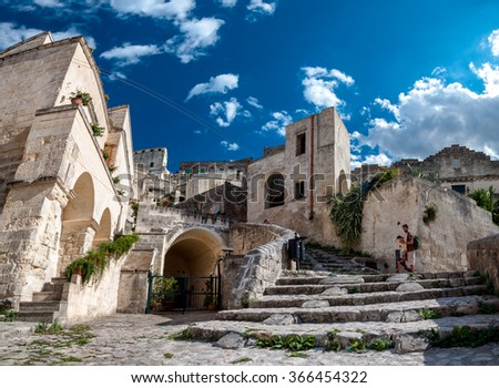 MATERA, ITALY  SEPTEMBER 15, 2014: Turists visit ancient town of Matera Sassi di Matera. The city is a UNESCO World Heritage site and European Capital of Culture for 2019 - stock photo