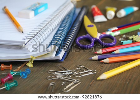 Material for school, paper clips, pencils, colors, scisor and notebook - stock photo