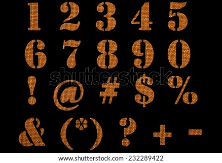 Material textured numbers, signs and symbols isolated on black background. - stock photo