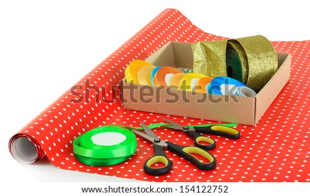 Materials and accessories for wrapping gifts isolated on white - stock photo