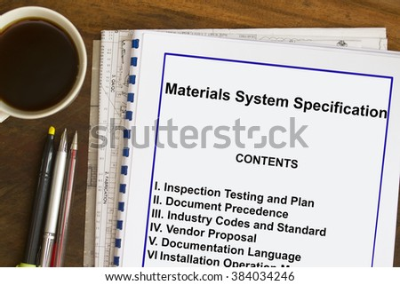 Materials System Specification with coffee , documents and ball pen. - stock photo