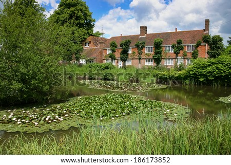 MATFIELD, KENT/UK - JUNE 13 : View of the pond and houses in Matfield Kent on June 13, 2004 - stock photo