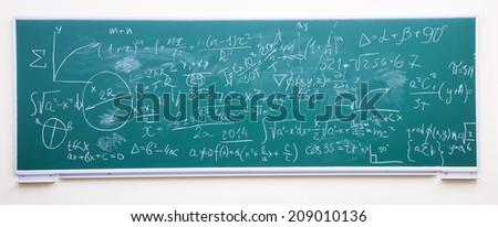 math formulas on green chalkboard - stock photo
