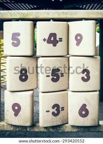 Math games on rotary white plates - stock photo