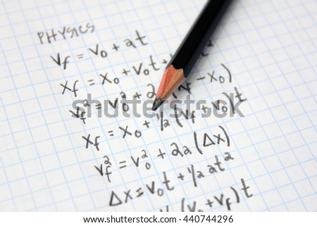 Math or physics problems on graph paper with pencil