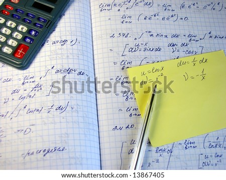 Mathematical formulas, printed calculation, a calculator and a pen - stock photo